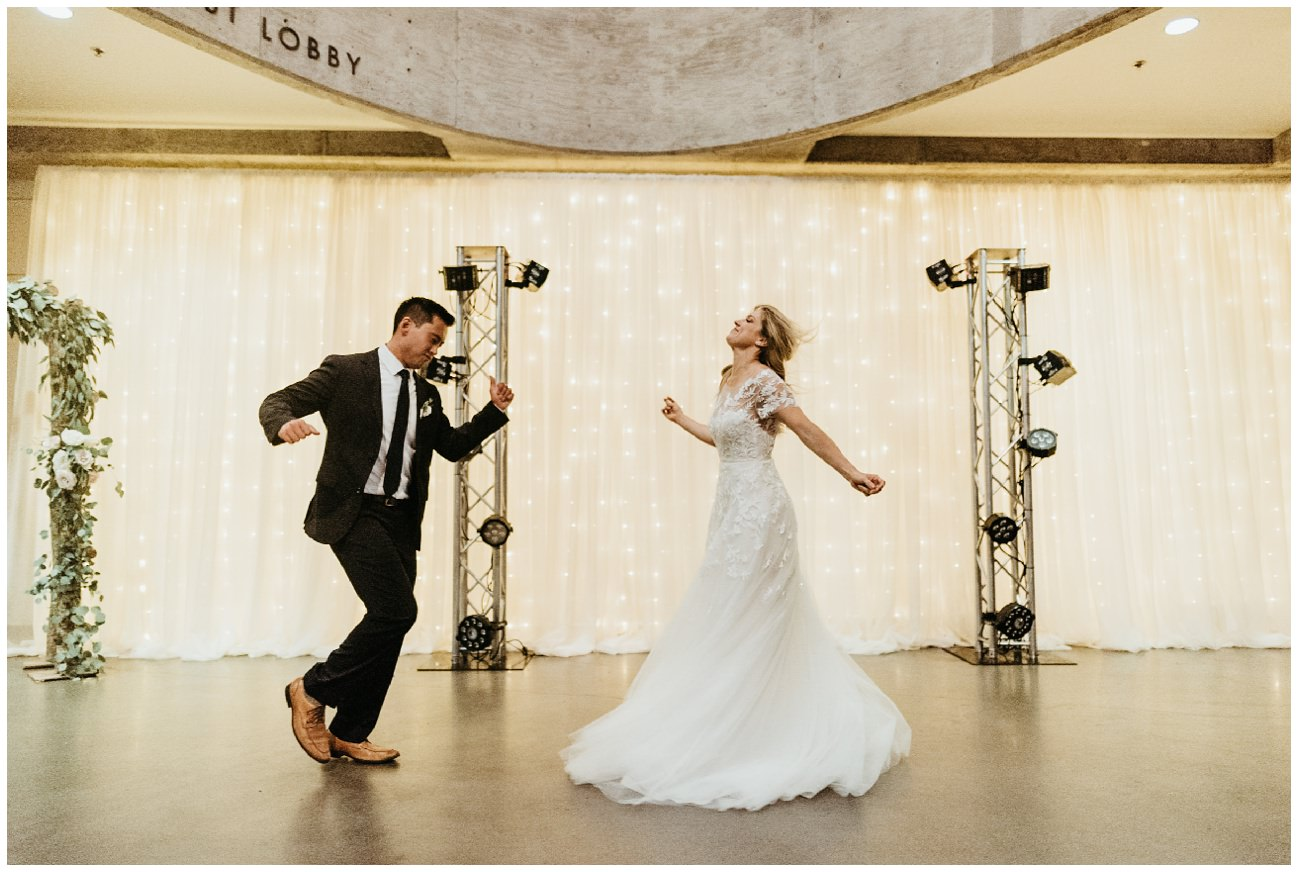 Darcy and Joey have their first dance at center stage at the armory wedding in portland Oregon